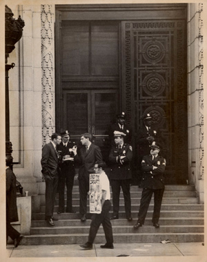 Officers on steps of the United States Customs House in Baltimore facing an anti-draft protest during the trial of the Catonsville Nine in October 1968